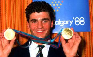 Pravi proboj među zvezde Tomba je doživeo u Kalgariju na Olimpijskim igrama 1988. kada je osvojio zlata i u slalomu i u veleslalomu, pobedivši svog idola Ingemara Stenmarka. Jedini neuspeh u Kanadi mu je bio što je prelepu nemačku klizačicu Katarinu Vit javno pozvao na večeru, ali je bio glatko odbijen.