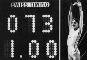 """Na Olimpijskim igrama u Montrealu 1976. godine istoriju gimnastike i sporta pisala je legendarna tada četrnaestogodišnja Nađa Komaneči. Za svoju vežbu na dvovisinskom razboju Nađa je dobila ocenu 10, što je bilo prvi put u istoriji gimnastike da je neko na Olimpijskim igrama dobio ocenu poznatu kao """"perfect 10""""."""