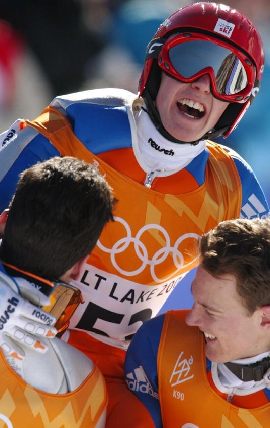 Na 19. Zimskim Olimpijskim igrama u Solt Lejk Sitiju 2002. godine niko nije računao na njega, što je Simon Aman maksimalno iskoristio i zbrisao sve rivale, osvojivši oba zlata u individualnim skokovima.