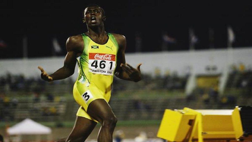 """Jusein Bolt je """"pomeo"""" konkurenciju u finalu trke na 200 metara u finalu Svetskog juniorskog prvenstva u Kingstonu."""
